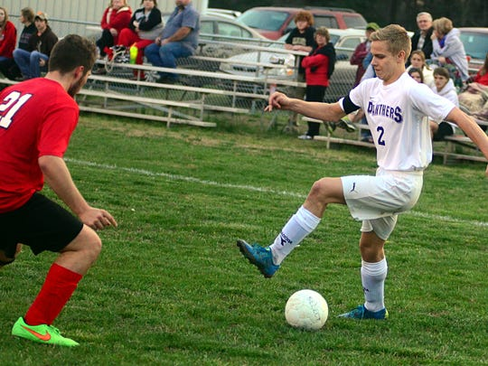 Portland High senior Dalton Creekmore dribbles in front of Westmoreland senior Griffin Garrison during first-half action. Creekmore scored a goal in the Panthers' 3-0 victory.