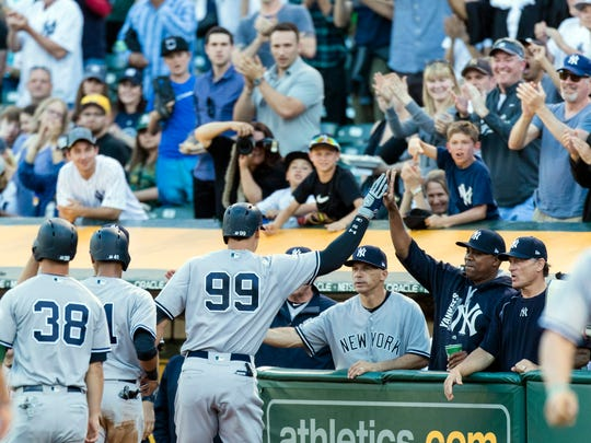Yankees right fielder Aaron Judge (99) celebrates after
