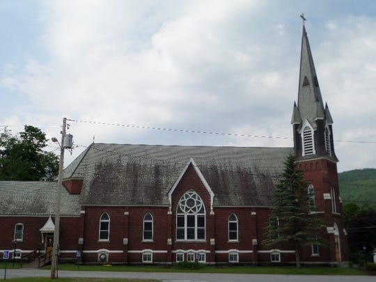 St. Thomas Church sits in the middle of Underhill Center. The gablets can be seen on the spire above the brick level on the right.