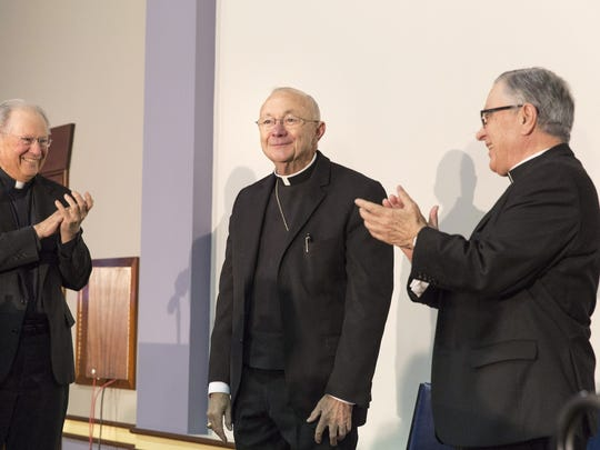 Former Bishop Michael Jarrell, right, and Bishop J.