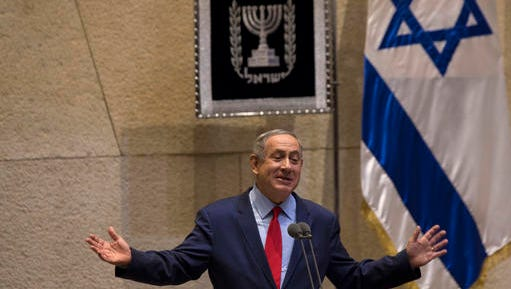 """FILE -- In this Oct. 31, 2016 file photo, Israeli Prime Minister, Benjamin Netanyahu, gestures during a speech at the Knesset, Israel's Parliament in Jerusalem, Monday, Oct. 31, 2016. Israel's Justice Ministry and police issued a brief statement late Wednesday, Dec. 28, 2016, that said they will issue an update """"in due time"""" about an ongoing probe into suspicions surrounding the prime minister. Israeli media are reporting that the attorney general is soon expected to announce a criminal investigation into Netanyahu. The Justice Ministry would not confirm the reports."""