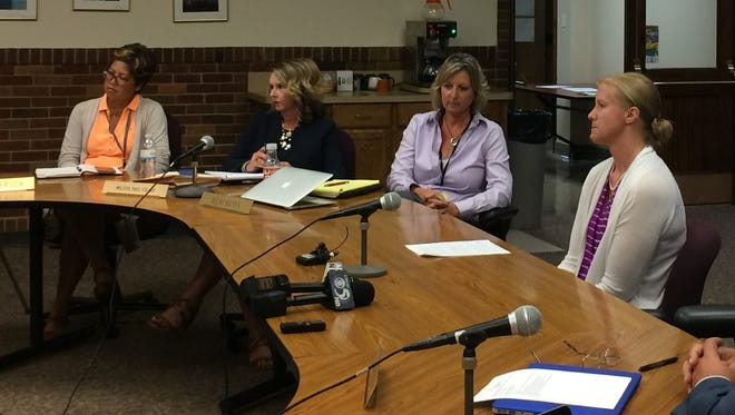 Former Washington Middle School teacher Kerstin Westcott, far right, addressed the Green Bay School Board about her ongoing concerns about safety at the middle school.