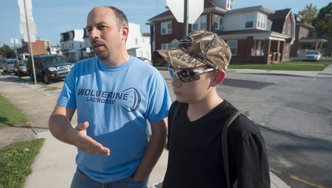 While standing along West Philadelphia Street in West York with his son Travis, 16, resident Shawn Speicher talks about recent events in regard to Mayor Charles Wasko. Speicher, who supported Wasko in his election, says the mayor's subsequent resignation is the best thing that could have happened to the borough in light of his racist Facebook posts and the resulting outrage.
