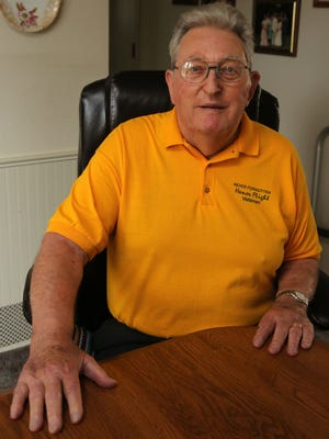 Korean War-era veteran Melvin Schmidt was photographed at his home in Marshfield earlier this month.