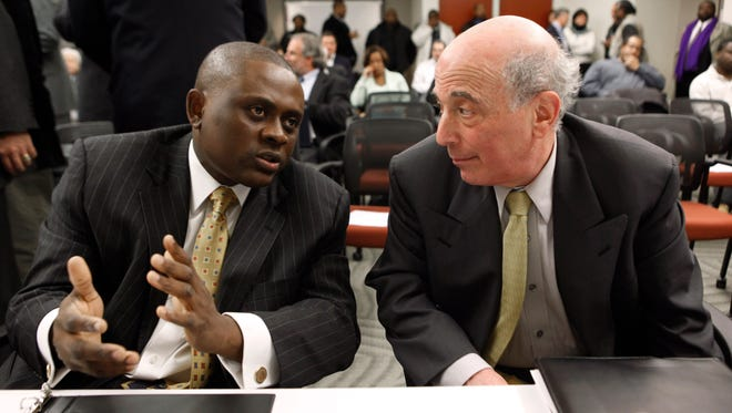"Dr. Bennet Omalu, left, Co-Director, Brain Injury Research Institute, West Virginia University talks with Dr. Ira R. Casson, Neurologist and former co-chairman, NFL Mild Traumatic Brain Injury Committee, before a House Judiciary Committee hearing entitled ""Legal Issues Relating to Football Head Injuries, Part II"" in Detroit, Monday, Jan. 4, 2010."
