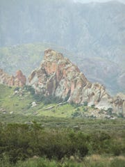 La Cueva at the base of the Organ Mountains, as seen from Baylor Canyon Road after rainstorm.