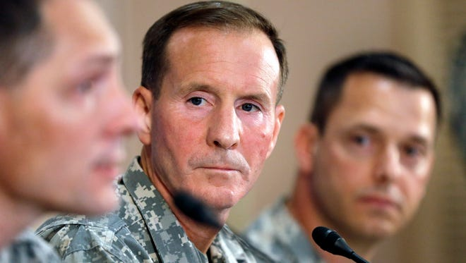 Maj. Gen. Joseph P. DiSalvo, U.S. Army South commander, center, and Col. Ronald Wool, right, listen to Col. Bradley Poppen, left, answer a question during a June 13, 2013, news conference on Sgt. Bowe Bergdahl.