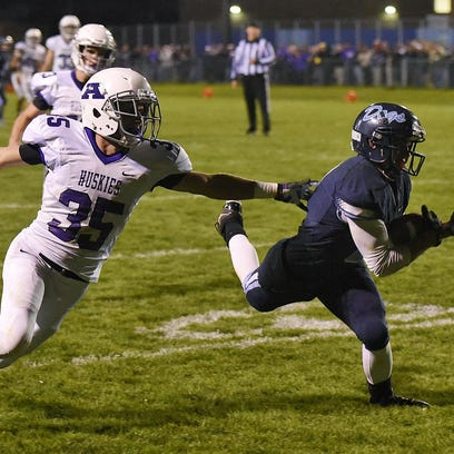 Becker's Beau Pauly brings down Albany quarterback Taylor Fourre for a loss during the first half Thursday in Becker.