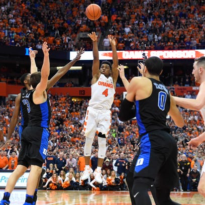 john Gillon (4) lets fly with his game- winning shot