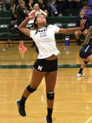 Novi junior Abryanna Cannon goes up for one of her