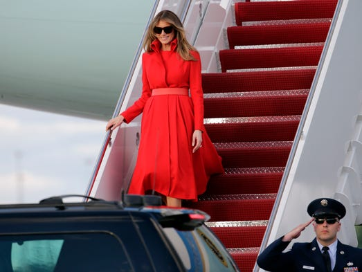 First Lady in red!  Melania Trump descends the stairs