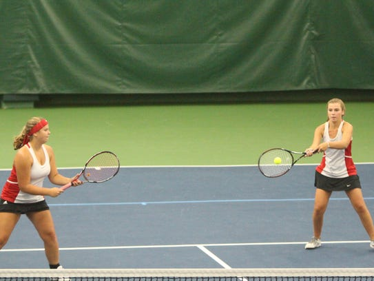 Muskego's Maddie Toboyek (right) backhands a ball with