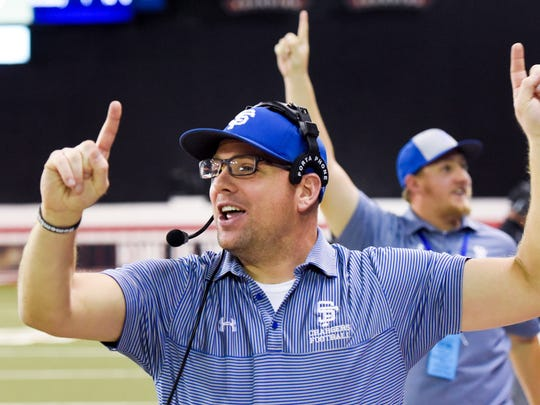 Sioux Falls Christian head coach Jake Pettengill holds up one finger to indicate No. 1 during the final seconds of the Class 11B football state championship game on Nov. 10, 2017 in Vermillion, S.D.. Sioux Falls Christian beat Bridgewater-Emery/Ethan 27-12.