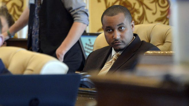Sen. Virgil Smith faces criminal charges over an incident earlier this year when he fired shots into his ex-wife's Mercedes outside his Detroit home.
