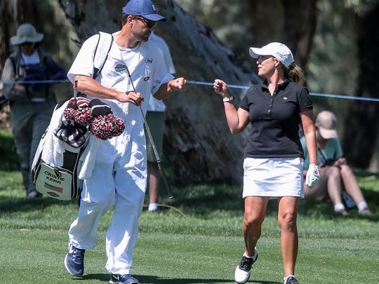 Cristie Kerr fist bumps caddie Brady Stockton on 9