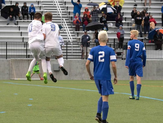 T.J. Tytler, left, and Alex Mowry celebrate after Mowry's free kick resulted in Tytler's 13th-minute goal that gave Bishop Kearney a 1-0 win Saturday and its first Section V title since 2010.
