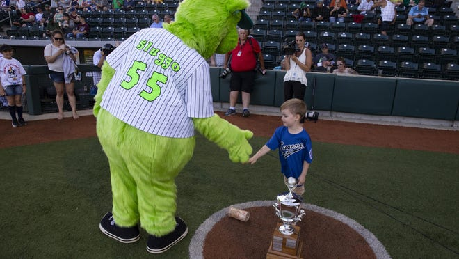 "Sluggo, the Eugene Emeralds mascot, greets 4-year-old Axel Job before the young baseball fan got to call out ""play ball"" over the loudspeaker to start at new season for the Ems in 2019. [Chris Pietsch/The Register-Guard] - registerguard.com"