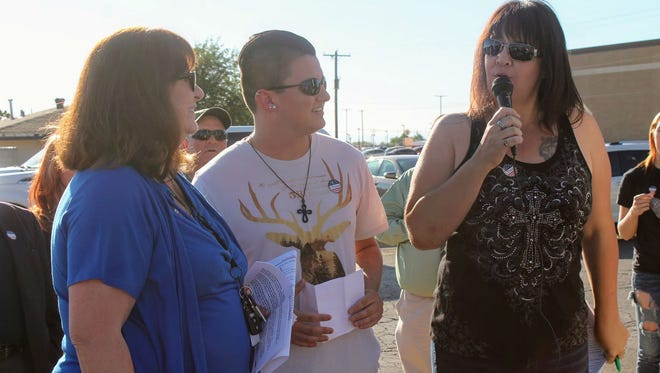 From left to right, Democratic Party of Otero County Chair Nadia Sikes, Green Party of Otero County Chair Ryan Sanders and Republican Party of Otero County Chair Amy Barela come together to recognize the National Day of Prayer Thursday, May 4, at Alamogordo's City Hall.