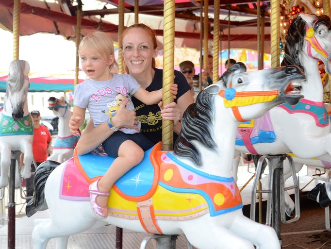 Susan Furrier enjoys a carousel ride with her daughter