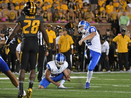 Middle Tennessee Blue Raiders place kicker Canon Rooker (15) kicks a field goal  during the second half against the Missouri Tigers at Faurot Field. Middle Tennessee won 51-45.