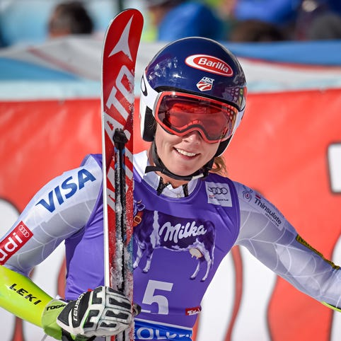 Lindsey Vonn, left, and teammate Mikaela Shiffrin stand at the finish area at the Rettenbach glacier, ahead of the women's giant slalom Ski World Cup race in Soelden, Austria, Oct. 23, 2015.