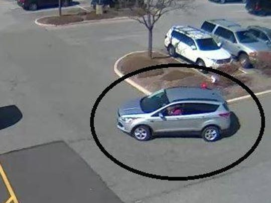 Police say the suspect in a wallet theft at Panera Bread drove this Ford Escape.