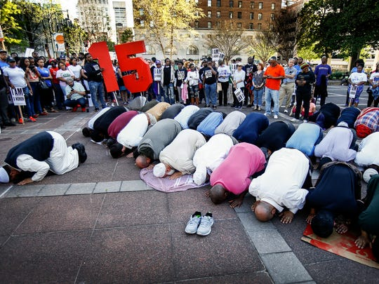 Local Muslims take part in afternoon prayer in front of City Hall during the Memphis 'Fight Racism, Raise Pay' protest Tuesday. Thousands of marchers walked from City Hall to the National Civil Rights Museum to shine a light on the legacy of Dr. Martin Luther King Jr. and the current fight for equal pay.