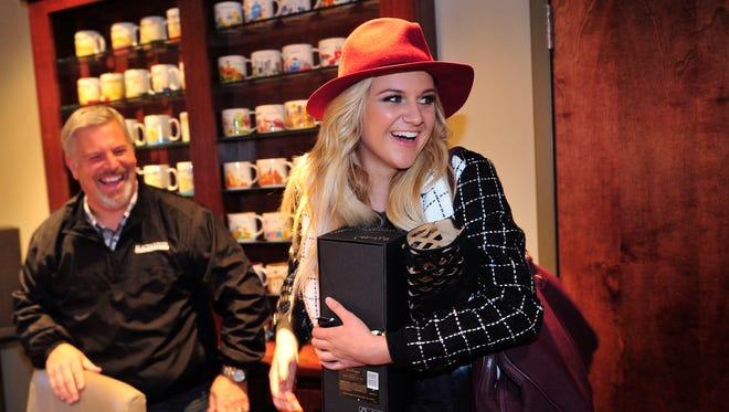 CEO Gordon Kerr, left, and Black River Entertainment breakout artist Kelsea Ballerini at the company's headquarters in Nashville.