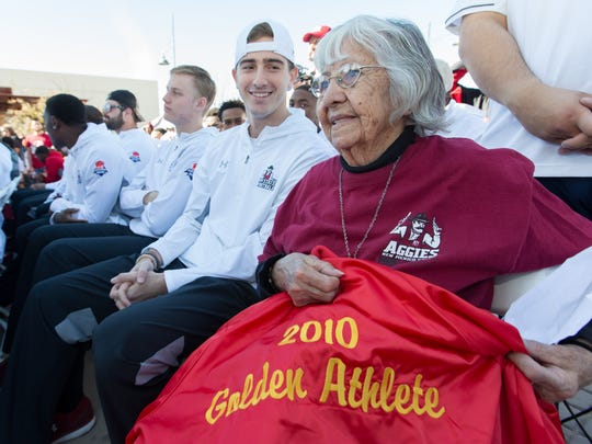 Amelia Davis gets to sit with her favorite football players on Saturday, January 20, 2018, during an Aggies celebration at Plaza de Las Cruces.