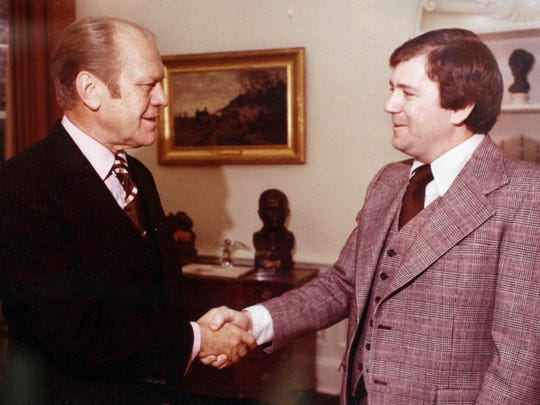 Ken Quinn greets President Gerald Ford while assigned to the White House's National Security Council, in this photo that hangs on his office wall at the World Food Prize in Des Moines.