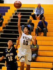 Wylie senior guard Steven Lopez floats a shot during Tuesday's game against Midland High. The Bulldogs won 88-51.