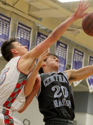 Dixie's Andrew Cox (15) battles Central Hardin's Stephen Thompson for a rebound during the Simon Kenton tournament, Thursday, Dec. 22, 2016.
