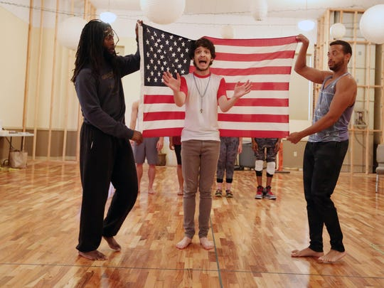 """Dwight Leslie, left, Jeremy Dalton and Chasdan Mike rehearse scenes for the upcoming production of Enlightened Theatrics' """"Hair: The American Tribal Love-Rock Musical."""" The show runs at the Grand Theatre July 31-Aug. 16."""