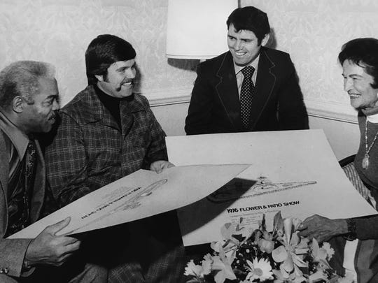 Ray Crowe (from left), director of Indianapolis Parks and Recreation; Jim Hobbs, president of the Indianapolis Horticultural Association; Dick Crum; and Thelma Schoenberger, co-director of the 1976 Indiana Flower and Patio Show, meet to discuss plans for the annual show.