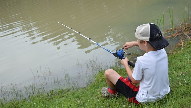 Davis Strickland fishes Tuesday in a pond at the Woodworth Education Center. The Louisiana Department of Wildlife and Fisheries is hosting its Summer Fishing Camp this week teaching children about bait and tackle, fish identification, fish cleaning, bowfishing and species-specific rigging for panfish, catfish and bass.