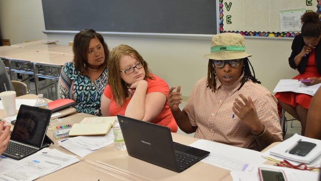 Stephanie Mason (left), Allison Ryals and Kendra Rutledge, all teachers at Alexandria Middle Magnet School, attend the Rapides Parish School District's 2015 Summer Institute session.