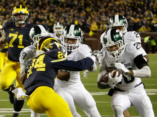 Michigan State's Jalen Watts-Jackson runs towards the end zone for the winning touchdown to beat Michigan, 27-23, after he picked up a muffed punt on the game's final play Oct. 17, 2015 at Michigan Stadium in Ann Arbor.