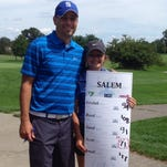Salem senior Darby Scott and Rocks head coach Ryan Nimmerguth are all smiles after Scott was medalist August 18 at the Highest Honors Tournament. She shot a 71, setting a new 18-hole record for Salem girls golf.