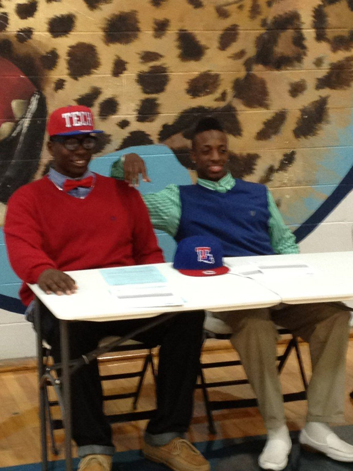 In this 2012 file photo, Vernon Butler, left, signs