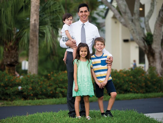 Austin Gomez with his three children: Carlos, 7, Evelyn,