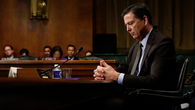 In this May 3, 2017, photo then-FBI Director James Comey pauses as he testifies before a Senate Judiciary Committee hearing in Washington, D.C. President Donald Trump abruptly fired Comey on May 9.