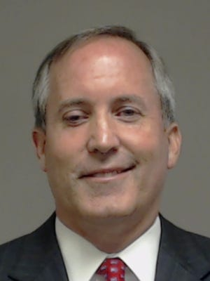 Texas Attorney General Ken Paxton surrendered to police Monday, Aug. 3, 2015, on three felony charges. Paxton, who has been attorney general since January, faces two securities fraud charges and a charge for failing to register with the state to sell securities.