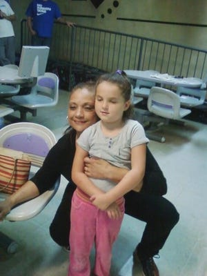 Kathi Jones, seen here with her granddaughter Madison, was found dead in November.