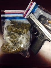 Officers with the Lafayette Marshal's Office recovered marijuana and an allegedly stolen handgun while serving a warrant.