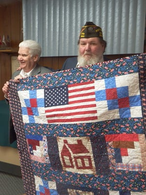District 99 Representative Jack Fortner (left) — whose district includes portions of Marion, Boone, Baxter and Searcy counties — was recently presented a quilt by Chuck Kinler, Commander of the of Bull Shoals VFW Post 1341. Rep. Fortner served in the US Navy during the Vietnam War. Rep. Fortner works toward the needs of veterans and his constituents as well as Environmental concerns and issues in the House of Representatives in Little Rock. The quilt was made by the Material Girls of Lakeview quilting club.