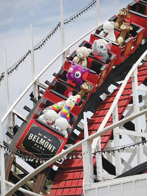 Stuffed animals ride the Giant Dipper roller coaster at Belmont Park in Mission Beach on June 1, 2020. The park has been running the coaster to keep it from tightening up during the recent closures. K.C. Alfred/San Diego Union-Tribune/TNS