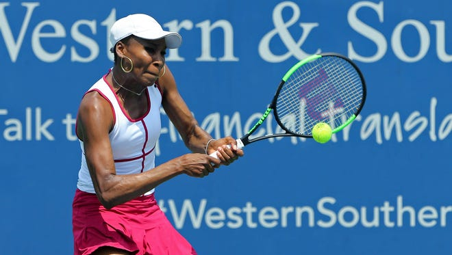 Venus Williams returns a shot against Ashleigh Barty during the Western and Southern Open at the Lindner Family Tennis Center on Aug. 16/