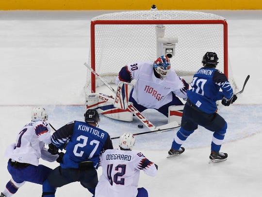 Finland forward Eeli Tolvanen (20) scores a goal against