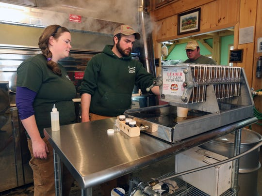 Mark and Jennifer Soukup, of Soukup Farms in Dover Plains, check the progress of the maple syrup in the sugar house on the property, March 25, 2017.
