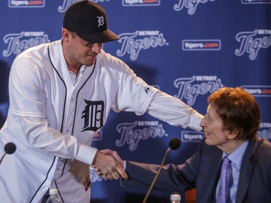 Jordan Zimmermann shakes hands with Tigers owner Mike